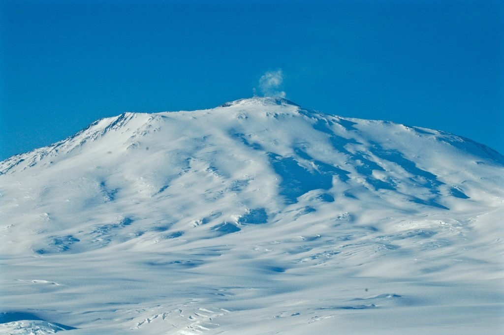 The mountain in our backyard: Mt. Erebus with a puff of volcanic exhaust on a rare, windless day. (The summit is over 12,000 feet).