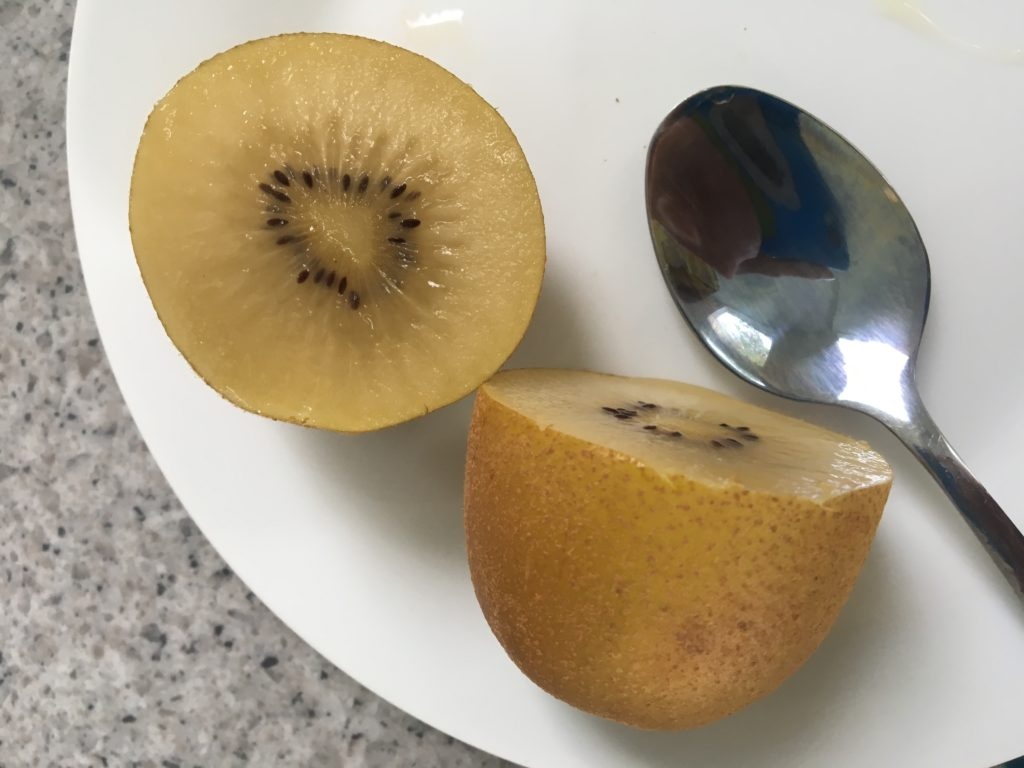 The clear yellow fruit of the delicious golden kiwi.